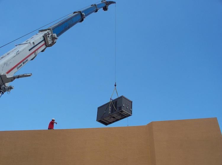 "<p><span style=""color: rgb(51, 51, 51);"">Lowering the Lennox unit onto the rooftop</span></p>"