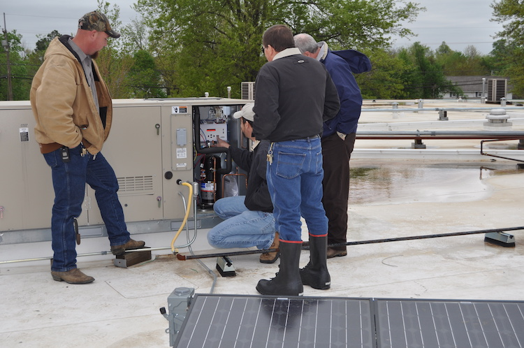 <p>Installing the Lennox unit and solar panel</p>