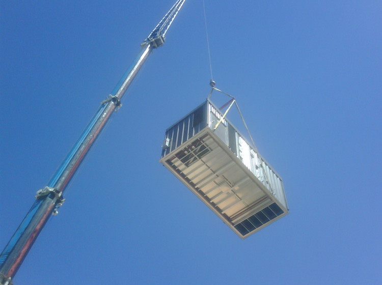 <p>Lowering the Lennox unit onto the rooftop</p>